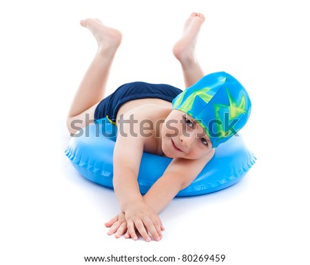 Little boy playing with blue life ring in swim caps, isolated in white - stock photo