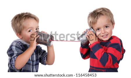 Little boy playing with can phone connected by string, concept for talking to yourself - stock photo