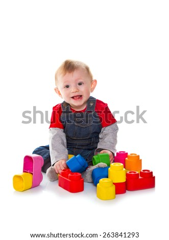 little boy playing with colored soft cube isolated on white - stock photo