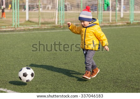 little boy playing with soccer or football ball. sports for exercise and activity. - stock photo