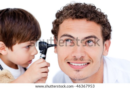 Little boy playing with the doctor at the hospital - stock photo