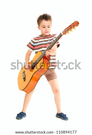 Little boy plays acoustic guitar isolated on white - stock photo