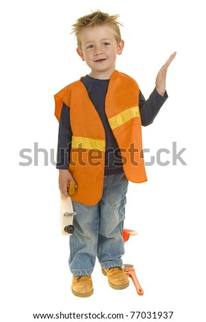 Little boy plays make believe as he dresses up as a construction worker to help his dad - stock photo