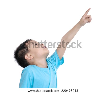 little boy pointing upward - stock photo