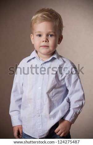 little boy portrait in shirt and jeans in studio - stock photo