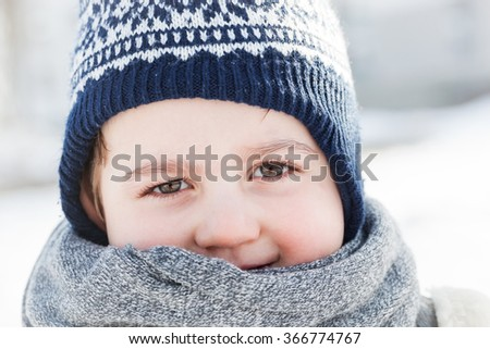 Little boy portrait in winter. Happy child face close-up.  - stock photo