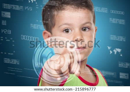 little boy pressing high tech type of modern buttons on a virtual background  - stock photo