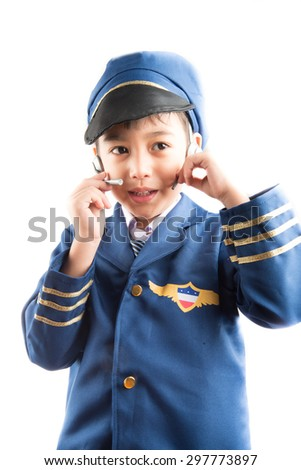Little boy pretend as a pilot on white background - stock photo