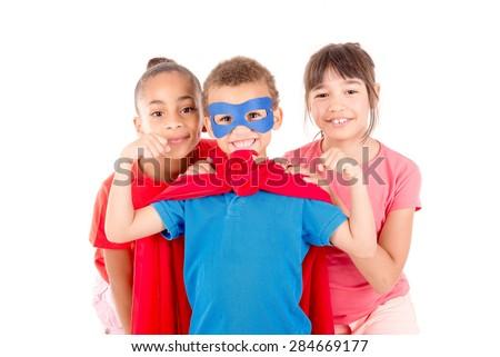 little boy pretending to be a superhero - stock photo