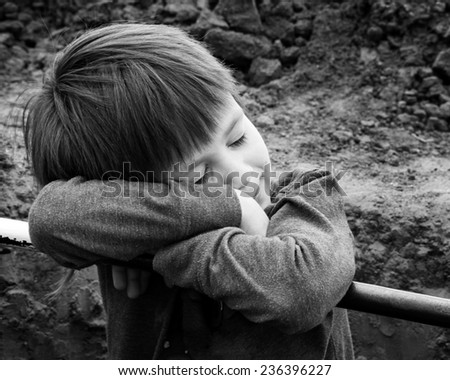 Little boy resting - stock photo