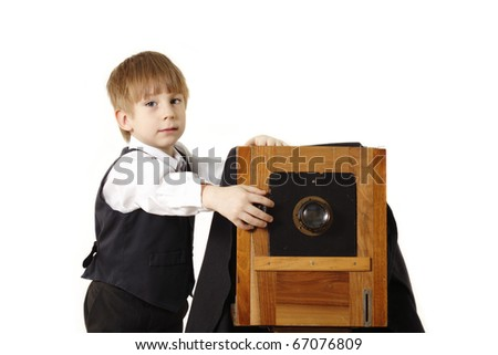 little boy retro photographer with vintage camera in studio isolated on white background - stock photo