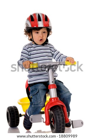 little boy riding bicycle - stock photo