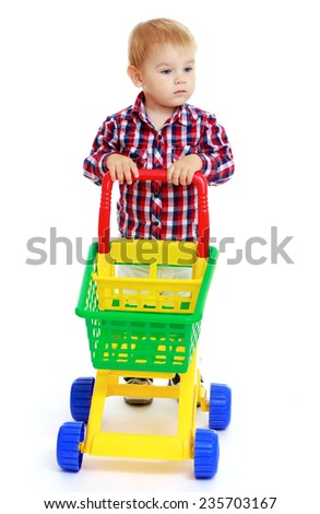 little boy rolls plastic toy truck.White background, isolated photo. - stock photo