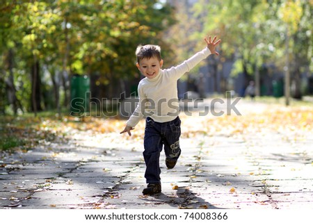 little boy runs in a summer park - stock photo