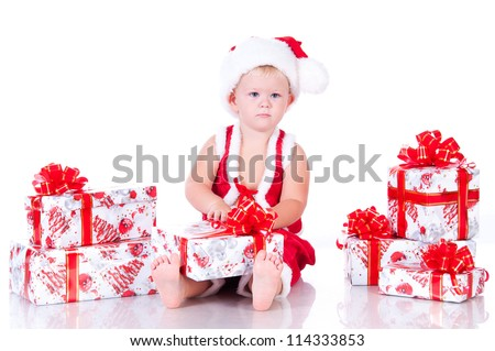 Little boy Santa Claus with Christmas gifts on a white background - stock photo