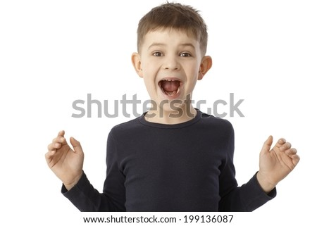 LIttle boy shouting happy, looking surprised with open arms. - stock photo