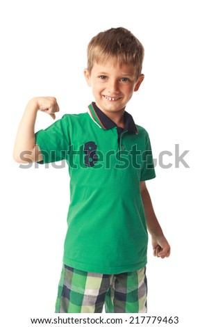 Little boy showing biceps isolated on white background - stock photo