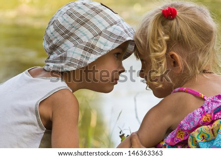 little boy showing his feelings for girlfriend - stock photo