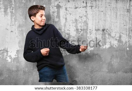 little boy showing something - stock photo