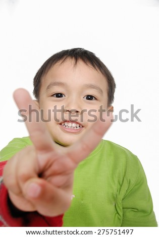 little boy showing victory hand sign - stock photo