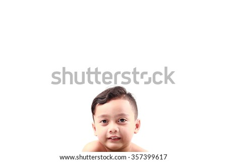 Little boy shows his funny face expression - stock photo