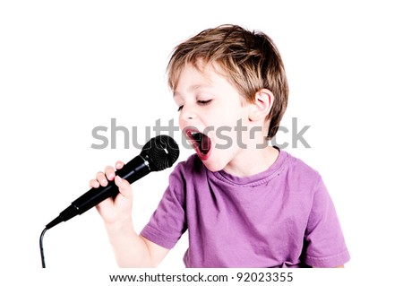 little boy singing through a microphone - stock photo