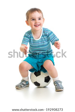 Little boy sitting on soccer ball isolated on white - stock photo