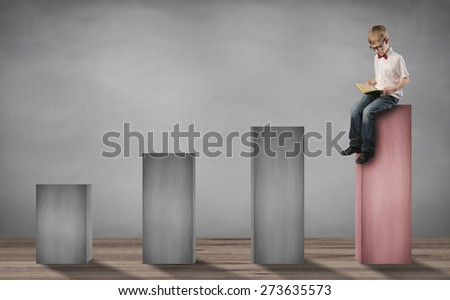 little boy sitting on the top step and reading a book - stock photo