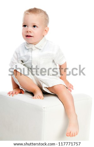 Little boy standing isolated over white background - stock photo