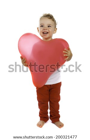 little boy standing with red heart balloon - stock photo