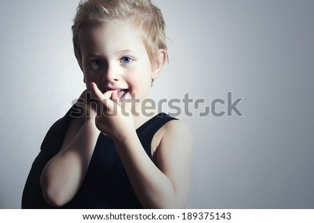 little boy.stylish haircut. fashion children.handsome blond kid.smiling child - stock photo