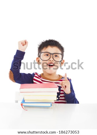 little boy think out a good ideas and raise hand - stock photo