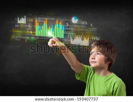Little boy touching colorful charts and diagrams - stock photo
