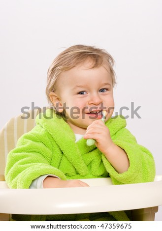 Little boy (two years) brushing teeth - stock photo