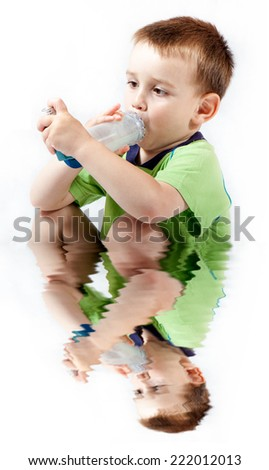 Little boy using inhaler for asthma isolated on white background with reflection on water - stock photo