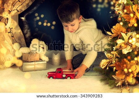 Little boy waiting for Santa Clause. - stock photo