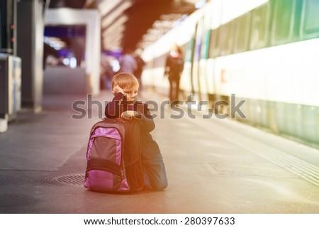 little boy waiting for the train on tube platform, kids travel - stock photo