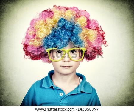 Little boy wearing clown wig in vintage technique - stock photo