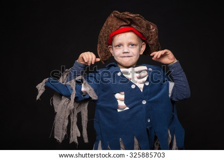 Little boy wearing pirate costume. Halloween. Studio portrait over black background - stock photo