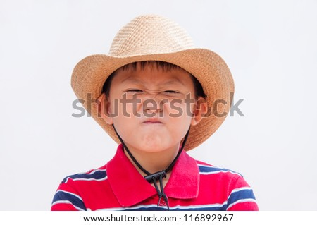 Little boy with a disgusted or fed up expression. - stock photo