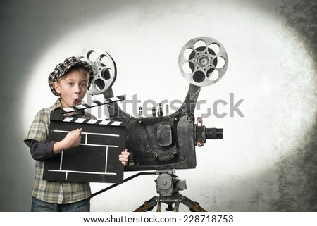 Little boy with a film projector - stock photo