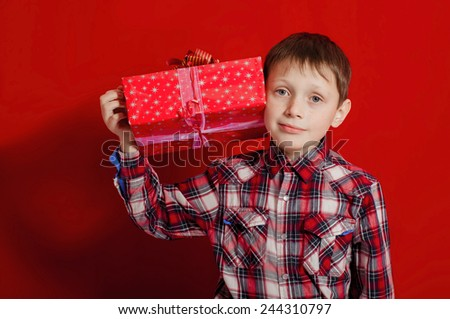 Little boy with a gift box in hands - stock photo