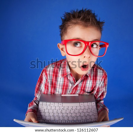 Little boy with a laptop, computer addiction concept - stock photo
