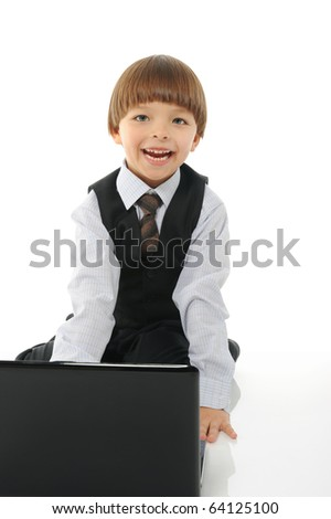 little boy with a laptop. Isolated on white background - stock photo