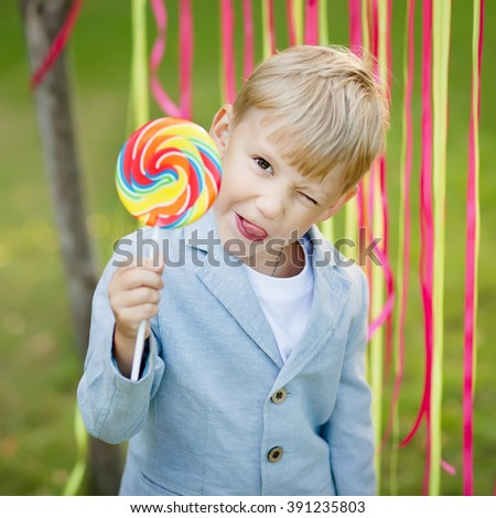 little boy with a red lollipop - stock photo