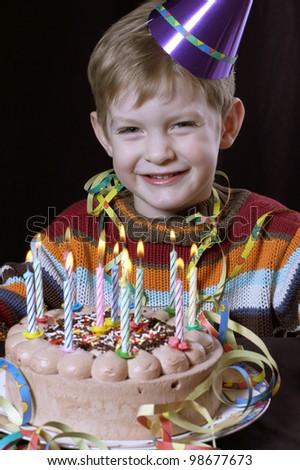 little boy with a tasty birthday cake - stock photo