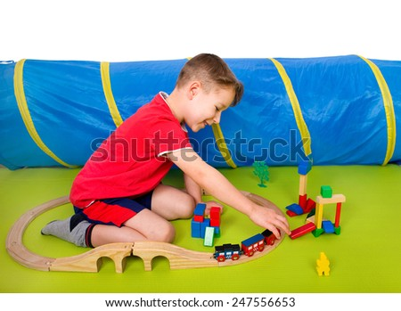 little boy with a train - stock photo