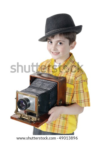 Little boy with an old camera on the white background - stock photo