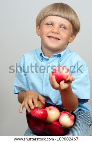 Little boy with apple - stock photo