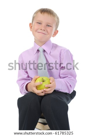 little boy with apple. Isolated on white background - stock photo